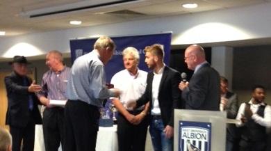 Martin Grange presents the award to James Morrison